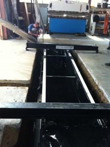 Installation de la fosse de garage pour entretien de véhicule léger