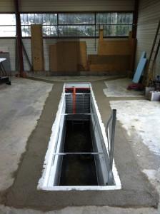 Scellement de la fosse mécanique dans le béton